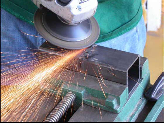 grinding a MIG welded tube
